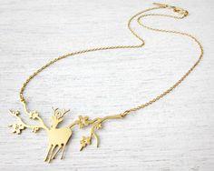 Short Miyajima Necklace in Gold, reindeer deer pendant jewelry woodland metal necklace holiday gift under 60. $50.00, via Etsy.