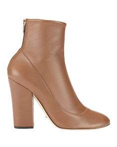 Sergio Rossi Virginia Bootie: A sleek and versatile soft leather bootie with a zipper closure at back heel. Chunky 3…