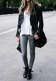 black leather jacket, white loose tank top, light grey skinny pants or light blue skinny jeans, black purse, and black short metal ankle boots with buckles.