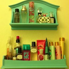 DIY bathroom shelves for perfume, body spray and lotion. Two thrift store shelves, painted and attached to wall. Cost= less than $10, and no more toilet divers from shelf above toilet!