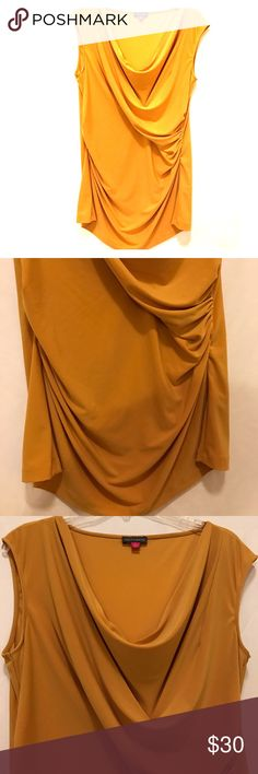 Vince Camuto Sleeveless Tunic Mustard yellow tunic in near perfect condition. Threads on hemline have unraveled (SEE PICTURE) Vince Camuto Tops Tunics