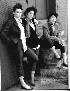 "Teddy Girls, also known as ""Judies"", often wore drape jackets, pencil skirts , hobble skirts , long plaits, rolled-up jeans, flat shoes, tailored jackets with velvet collars, straw boater hats , cameo brooches, espadrilles , coolie hats and long, elegant clutch bags."