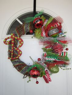 Whimsical Christmas Wreath - I like the monogram idea - but without the busy-ness of the other stuff.