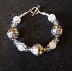 "8"" chunky silver and clear beaded bracelet.  Has a silver toggle clasp.  Goes with anything. Free shipping!"