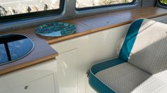Dub Interiors - love the fabric combination and the fresh look of the units / oak tops.