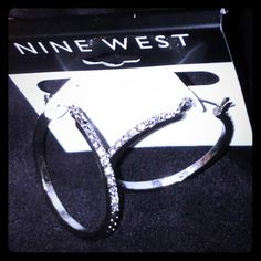 NEW Nine West earrings A dose of fabulous daily! These beautiful Silver circle hoop earrings with a smooth and classy CZ setting from end to end. Straight bar pin and snaps down in back (dangling effect); nickel free. Nine West Jewelry Earrings