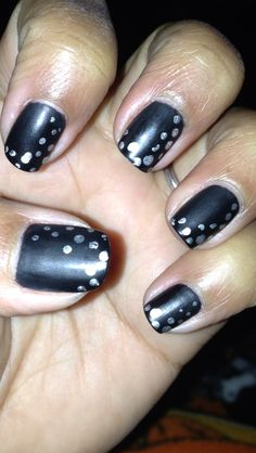 Butter matte black and Sally Hansen chrome silver dots made with the head of a straight pin.