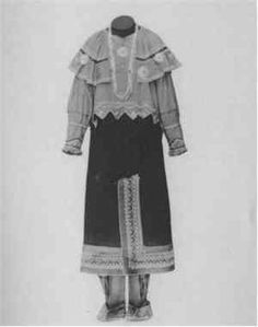 Traditional Potawatomi dress.  The large shawl was used as a hood for windy conditions, particularly those in Kansas and Oklahoma.