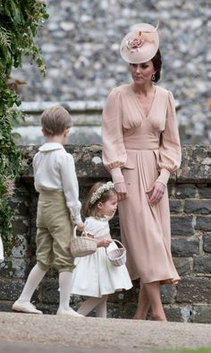 Catherine Duchess of Cambridge with Prince George of Cambridge and Princess Charlotte of Cambridge attend the wedding of Pippa Middleton and James...