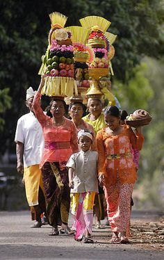 Going to Pura by letjen - One family goes together to Pura Alas Kedaton, Tabanan, Bali to worship God. Hindu is a majority religion in Bali, and it's kept both as a religion and culture