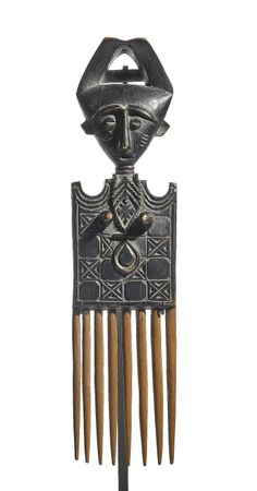 Africa | Comb from the Asante people of Ghana | Wood; varied medium and brown patina | ca. early 1960s