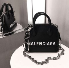 BagBag BALENCIAGA Triple S Trainers Triple S Shoes Woman f Balenciaga Slash Heel Pumps Balenciaga Bag 🌈 Balenciaga Ville Small Top Handle Bag in black small grain calfskin Want Womens Petite Size 2 Rockstud Strap Heeled Sandals Luxury Purses, Luxury Bags, Luxury Handbags, Designer Handbags, Hand Bags Designer, Black Designer Bags, Designer Shoes, Cheap Handbags, Prada Handbags