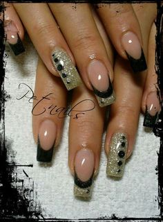 Black and gold french nail design with accent nails