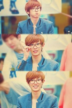 Chanyeol lol lookin like a hipster the way he holds the glasses