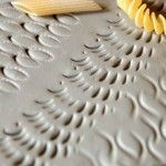 Tiles imprinted with pasta - Great Texture idea. Perfect for tessellations (repeating Patterns).