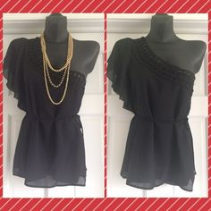Just In One Shoulder Black Top Size S Beautiful One Shoulder Top.  Size S.  Black.  Boutique brand.  Bought abroad.  Ties at the waist.  100% Polyester.  Dry clean. Necklace NOT included. Violet's Finds Tops