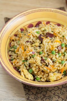 A low-carb, Paleo-friendly alternative to fried rice, with plenty of deliciously crispy bacon throughout all of the veggies.