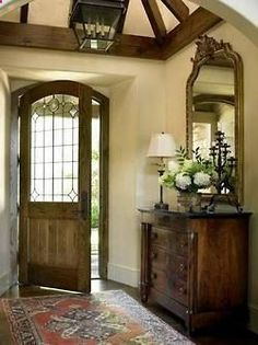 What a beautiful foyer! #foyer #wainscoting #design #craftsman explore…
