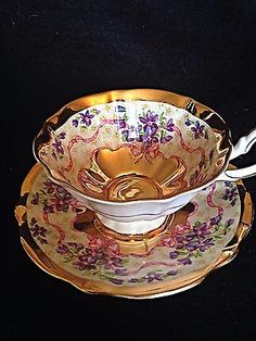 Queen Anne violets, gold guilt, pink bows,  bone china cup and saucer