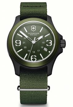 Victorinox Mens Green Dial Fabric Strap Original Watch 241514.  This Mens Victorinox watch has a nylon fiber case which is set around a green dial with luminescent hands and index, and date window. It features mineral crystal, brushed aluminum bezel, and screw-in caseback. A green fabric strap completes the look. Water resistant to 100M.