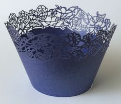 Beautiful Navy Blue Petite Fleurs (Small Flowers & Roses) Filigree Lace Wrappers for your cupcakes.  You will receive:   This is a brand new 12 piece lace collar or wrapper for standard size cupcake liners.  Beautiful and elegant for weddings and special celebrations.  Pearlized cupcake wrappers made from sturdy card stock paper.  The lace wrapper measurements: 8 4/8 X 2 (flat) but will be folded around a standard size cupcake liner  *One quantity equals to 12 cupcake wrappers, two…
