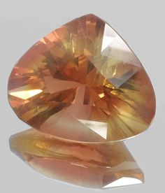 OREGON SUNSTONE TRILLIANT NEON PEACHY ORANGE AND GOLD 17.17 CT SEE VIDEO $1,290.00 FREE EMS express shipping world wide 5-8 days delivery pay pal required we only accept paypal  Exceptionaly large and top quality, AAll merican gem   Only copper bearing sunstone  guarenteede world this piece exceptional lare shows strong dichroism pleochroism 3 colors flash out of this perfectly cut american treasure . from thailand office I am kenneth Barnett american living in Thailands largest cutting…