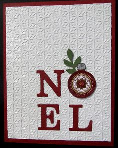 A snowburst embossing file is a perfect background for the simple NOEL message.  Changing the O into an ornament adds a nice touch to this handmade Christmas card.
