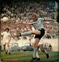 25th August 1973. Coventry City centre forward Colin Stein puts Tottenham under pressure as they won 1-0,  at Highfield Road.