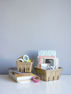 Spray paint your berry baskets for a cute desk organizer.   33 Impossibly Cute DIYs You Can Make With Things From Your Recycling Bin