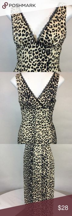 Bebe Women's Size S Cheetah Print stretch dress Gently used No flaws  Measurements laying flat  Bust 15 in  Waist 13 in  Hips 17 in  Length 40 in bebe Dresses Midi