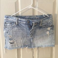 Distressed Jean American eagle skirt. Used a few times, it still looks new, it need a little ironing. American Eagle Outfitters Skirts Mini