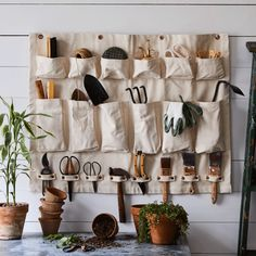 A canvas wall organizer featuring a variety of compartment sizes that'll offer up a unique storage solution for a multitude of things. Think: garden tools, kitchenware, crafting supplies, and more. Canvas Hangers, Wall Organization, Tool Shed Organizing, Home And Deco, Garage Storage, My New Room, Home Improvement Projects, Wall Canvas, Garden Tools