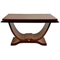 Art Deco Table, Manner of Ruhlmann, with Molded Top and Curved Platform Base