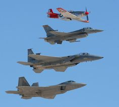 "An air force ""Heritage Flight"" with three generations of American fighters in formation ( a P-51, F-16, F-15 and F-22)."