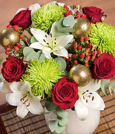 Golden Sparkle...A contemporary display of luxurious Upper Class red Roses, crisp white Asiatic Lilies and red festive berries. #bunchesuk