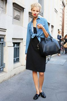 Denim button-up tied over a black dress.