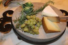 Cheese platter, love the garnish of leek ends...