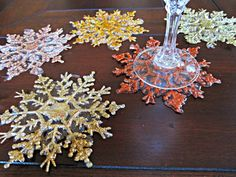 DIY Iced Snowflake Coasters Tutorial from Dollar Store Crafts - would do these in a different color scheme, but great inexpensive idea!