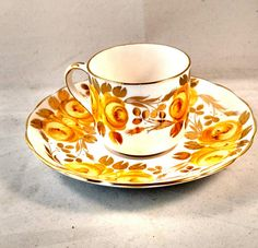 DISCOUNT.....10% OFF purchase of 2 or more items priced $25 or more each. Vintage Demitasse Cup and Saucer Yellow Rose Transfer Gold Trim Tea Rose pattern Produced by Grosvenor China, England 2 1/2 high 2 1/2 cup diameter 5 1/2 saucer diameter No chips, No cracks, No crazing