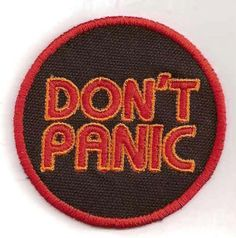"""Inspired by """"The Hitchhiker's Guide to the Galaxy"""", this patch simply proclaims """"Don't Panic"""". It's stitched in red and gold thread on a black canvas Cute Patches, Pin And Patches, Sew On Patches, Iron On Patches, Jacket Patches, Kunst Shop, Hitchhikers Guide, Guide To The Galaxy, Don't Panic"""