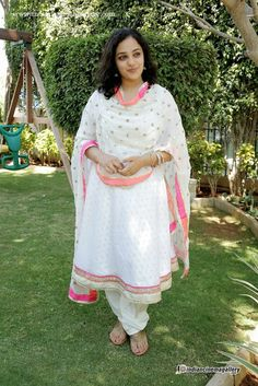 Nithya Menen is an Indian film actress and playback singer, who works in the South Indian film industries. Nithya Menen was born in Banglo. Pakistani Dress Design, Pakistani Dresses, Indian Sarees, Churidar Designs, Indian Designer Suits, Most Beautiful Indian Actress, Beautiful Hijab, Curvy Women Fashion, Indian Celebrities
