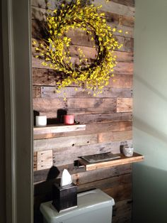 DIY pallet wall in a small powder room! Just did this myself and it looks amazing.
