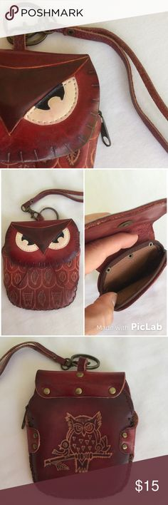 "🎉HP 9/5/16🎉Cute Owl Coin Purse All Leather Wristlets/coin purse is so Adorable! Big Owl Eyes👀on front flap with magnetic closure. Zippered compartment keeps your $ secure. Clip on leather hand strap to carry and key ring attached. Rich burgundy/brown tone highlighted with hand-tooled ""feather"" accents. Antiqued Brass hardware. Measures 4 1/2"" tall X 4"" wide. NWOT🎉HP 9/5🎉""Best in Bags"" party🎉 courtesy @anaism06💋 Bags Clutches & Wristlets"