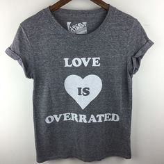 """[Local Celebrity] Love Is Overrated Gray Graphic T Perfect t for any single ladies or someone getting over a breakup! Very soft. Cuffed sleeves. Has a vintage look to it. Material is textured. Tried to show in last picture.  Color: Gray & White Fabric: Polyester, Rayon. Spandex Size: Small Bust: 16"""" Length: 23"""" Condition: GUC. Gently worn. No flaws.  No Trades! No PayPal! Local Celebrity Tops Tees - Short Sleeve"""