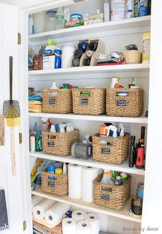 Messy storage closet no more! Woven baskets labeled with mini chalkboards and magazine holders for storing water bottles!