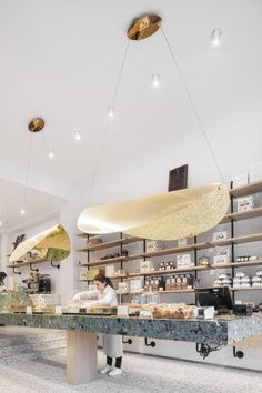 Dandoy, Belgium's most renowned biscuit shops. New Dandoy store on Place Stéphanie, Brussels center. Ceiling lamps designed by Belgian designer Nathalie Dewez.