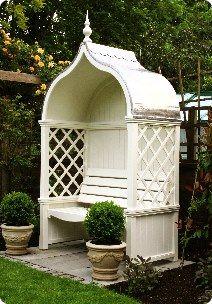 Windsor Arbour Garden Seat - This company (HSP Garden Buildings of Dublin, Ireland) has many adorable garden structures...