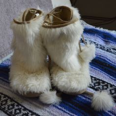 "Fossil White Tan Furry House Slippers Boots Was a present. Worn once for this photo. Very warm and comfy. No exact size, label says ""small."" Fossil Shoes Slippers"