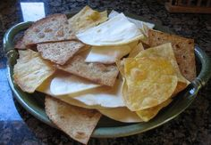 Homemade baked tortilla chips - I made these last night and they were delicious! Take your favorite tortilla, mist with a little oil on one side (I mixed lime juice with mine), salt, and then bake for 10 min at 400 degrees. DELICIOUS.