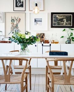 We love a good gallery wall in the dining room or any room for that matter! Loving the tones of white and wood in this space with the pop of greenery on the table!